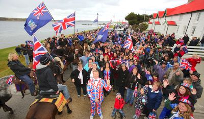 Residents gather in Stanley, Falkland Islands on March 10, 2013, during a referendum intended to show the world that they want to stay British amid increasingly bellicose claims by Argentina. AFP PHOTO / Tony Chater        (Photo credit should read TONY CHATER/AFP/Getty Images)