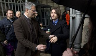 Amanda Knox's Italian ex-boyfriend Raffaele Sollecito, right, arrives at Italy's highest court building, in Rome, Wednesday, March 25, 2015. (AP Photo/Alessandra Tarantino)