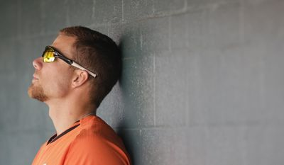 Baltimore Orioles first baseman Chris Davis pauses in the dugout during the seventh inning of a spring training exhibition baseball game against the Pittsburgh Pirates in Bradenton, Fla., Tuesday, March 24, 2015. (AP Photo/Carlos Osorio)