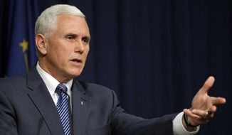 Indiana Gov. Mike Pence holds a news conference at the Statehouse in Indianapolis, Thursday, March 26, 2015. (AP Photo/Michael Conroy)