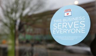 A window sticker on a downtown Indianapolis business, Wednesday, March 25, 2015, shows its objection to the Religious Freedom bill passed by the Indiana legislature. Organizers of a major gamers' convention and a large church gathering say they're considering moving events from Indianapolis over a bill that critics say could legalize discrimination against gays. (AP Photo/Michael Conroy) **FILE**