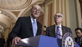 FILE - In this March 3, 2015 file photo, Sen. Charles Schumer, D-N.Y., left, accompanied by Senate Minority Leader Harry Reid, D-Nev., speaks during a news conference on Capitol Hill in Washington. Reid is backing Schumer to succeed him as Democratic leader.  Reid issued his endorsement Friday morning, shortly after announcing he would be retiring next year instead of running for re-election.  (AP Photo/J. Scott Applewhite, File)