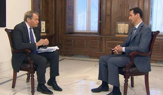 "In this frame grab from video provided by CBSNews/60 Minutes, in New York, ""60 Minutes"" contributor Charlie Rose, left, interviews Syrian President Bashar Assad, Thursday, March 26, 2015, in Damascus, Syria. Assad says he would be open to a dialogue with the United States, but that it must be ""based on mutual respect,"" during the interview scheduled to be broadcast Sunday, March 29. (AP Photo/CBSNews/60 Minutes)"