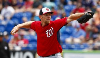 Washington Nationals starting pitcher Stephen Strasburg works in the first inning of an exhibition spring training baseball game against the New York Mets, Saturday, March 28, 2015, in Port St. Lucie, Fla.  (AP Photo/John Bazemore)