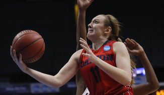 Dayton forward Ally Malott (11) shoots past Louisville forward Shawnta' Dyer during the first half of a women's college basketball regional semifinal game in the NCAA Tournament on Saturday, March 28, 2015, in Albany, N.Y. (AP Photo/Mike Groll)