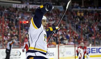 Nashville Predators center Mike Ribeiro (63) celebrates his goal in the second period of an NHL hockey game against the Washington Capitals, Saturday, March 28, 2015, in Washington. (AP Photo/Alex Brandon)