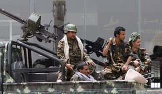 """Shiite rebels, known as Houthis, wearing an army uniform, ride on an armed truck to patrol the international airport in Sanaa, Yemen, Saturday, March 28, 2015. Yemen's President Abed Raboo Mansour Hadi, speaking at an Arab summit in Egypt on Saturday, called Shiite rebels who forced him to flee the country """"puppets of Iran,"""" directly blaming the Islamic Republic for the chaos there and demanding airstrikes against rebel positions continue until they surrender. (AP Photo/Hani Mohammed)"""