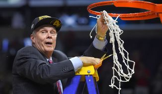 Wisconsin head coach Bo Ryan cuts down the net after Wisconsin beat Arizona 85-78 in a college basketball regional final in the NCAA Tournament to advance to the Final Four, Saturday, March 28, 2015, in Los Angeles. (AP Photo/Mark J. Terrill)