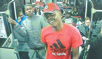 Authorities in St. Louis, Mo. are looking for this suspect after a man was beaten on a local train on Monday, March 23. The victim refused to engage in a conversation about Michael Brown. (Image: St. Louis Metro)