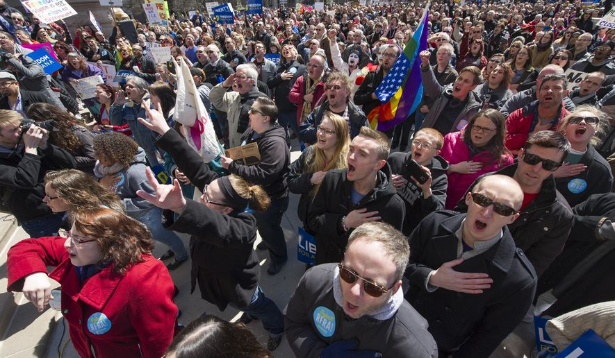 Thousands of opponents of Indiana Senate Bill 101, the Religious Freedom Restoration Act, gathered on the lawn of the Indiana State House to rally against that legislation Saturday, March 28, 2015. Indiana's law has been widely criticized by businesses and organizations around the country. (Associated Press) **FILE**