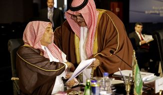 Saudi Foreign Minister Saud bin Faisal bin Abdulaziz Al Saud reviews a document during an Arab foreign ministers meeting in Sharm el-Sheikh, South Sinai, Egypt, Sunday, March 29, 2015. Arab League member states at a summit in this Red Sea resort have agreed in principle to form a joint inter-Arab military peacekeeping force. The agreement is a telling sign of a new determination among Saudi Arabia, Egypt and their allies to intervene aggressively in regional hotspots, whether against Islamic militants or spreading Iranian power. (AP Photo/Thomas Hartwell)