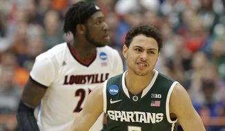 Michigan State's Bryn Forbes (5) reacts after making a 3-point basket during the first half of a regional final against Louisville in the NCAA men's college basketball tournament Sunday, March 29, 2015, in Syracuse, N.Y. (AP Photo/Seth Wenig)