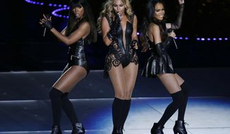 FILE - In this Feb. 3, 2013 file photo, members of Destiny's Child, from left, Kelly Rowland, Beyonce, and Michelle Williams, perform at Super Bowl XLVII, in New Orleans. A reunited Destiny's Child took the stage at the Stellar Gospel Music Awards on Saturday, March 28, 2015. (AP Photo/Gerald Herbert, File)
