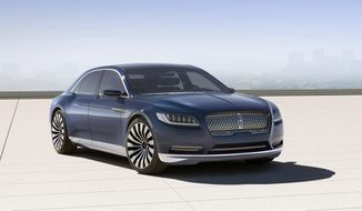 This product image provided by the Ford Motor Co. shows the new Lincoln Continental concept. Thirteen years after the last Continental rolled off a Michigan assembly line, Ford Motor Co. is debuting the new Continental in concept form at the New York Auto Show on Monday, March 30, 2015.The production version goes on sale next year. (AP Photo/Ford Motor Co.)