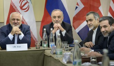 working late: Members of the Iranian delegation (from left) Foreign Minister Javad Zarif, atomic energy director Ali Akbar Salehi, presidential aide Hossein Fereydoun and Deputy Foreign Minister Abbas Araghchi are meeting with delegates from Britain, Russia, China, France, Germany, the European Union and the U.S. (Associated Press)