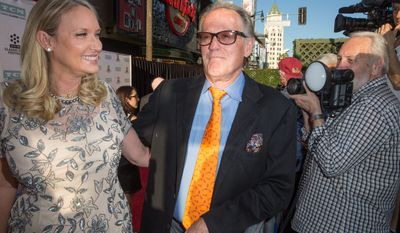 """Parky Fonda, left, and Peter Fonda arrive at the 2015 TCM Classic Film Festival Opening Night Gala """"The Sound Of Music"""" at TCL Chinese Theatre on Thursday, March 26, 2015 in Los Angeles. (AP) (Associated Press)"""