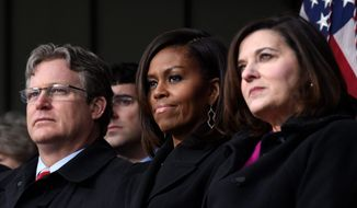 First lady Michelle Obama (center), flanked by Connecticut State Sen. Ted Kennedy Jr. (left) and Victoria Reggie Kennedy, attends the dedication of the Edward M. Kennedy Institute for the United States Senate in Boston Monday, named for the late senator. The $79 million project's unveiling was attended by President Obama, Vice President Joseph R. Biden and senators of both parties, many of whom had friendly feuds with Kennedy. (associated press)