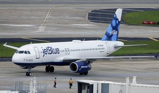 In this May 15, 2014, file photo, a JetBlue Airways Airbus A320-232 pushes back from the gate at the Tampa International Airport in Tampa, Fla. (AP Photo/Chris O'Meara) ** FILE **