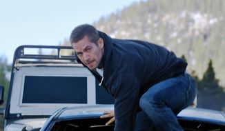 "This photo provided by Universal Pictures shows, Paul Walker as Brian, in a scene from ""Furious 7.""  (AP Photo)"