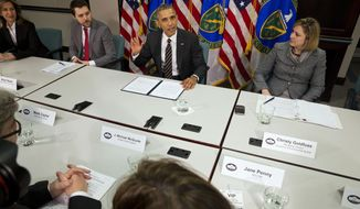In this March 19, 2015, file photo, President Barack Obama, flanked by senior adviser Brian Deese, left, and Christina Goldfuss, managing director of the Council on Environmental Quality, speaks at Energy Department in Washington. (AP Photo/Jacquelyn Martin)