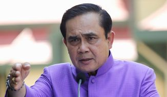 Thai Prime Minister Prayuth Chan-ocha asked the king for approval to lift martial law, but the request was considered a mere formality. (Associated Press)