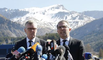 CEO of Germanwings Thomas Winkelmann, left, and Lufthansa CEO Carsten Spohr attend a press conference near the site of the Germanwings jet crash, in Le Vernet, France, Wednesday, April 1, 2015. (AP Photo/Claude Paris)