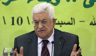Palestinian President Mahmoud Abbas speaks during a meeting of the Fatah revolutionary council in the West Bank city of Ramallah in this Oct. 18, 2014, file photo. (AP Photo/Majdi Mohammed, File)
