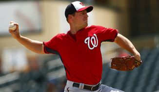 Washington Nationals starting pitcher Jordan Zimmermann (27) works in the first inning of an exhibition spring training baseball game against the Miami Marlins Wednesday, April 1, 2015, in Jupiter, Fla. (AP Photo/John Bazemore)
