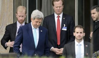 U.S. Secretary of State John Kerry, front left,  walks  during a break outside the Beau Rivage Palace Hotel as the Iran nuclear talks continue, in Lausanne, Switzerland, Wednesday, April 1, 2015. (AP Photo/Keystone,Laurent Gillieron)
