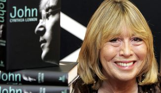 "In this Sept 26, 2005, file photo, Cynthia Lennon, the first wife of Beatles band member John Lennon, sits behind copies of her newly released book titled ""John"" during a book signing at Foyle's bookshop in central London. Cynthia Lennon died on Wednesday, April 1, 2015, at her home in Mallorca, Spain, following a short battle with cancer. (AP Photo/ Jane Mingay, File)"
