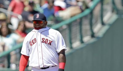 Boston Red Sox third baseman Pablo Sandoval bites on the collar of his shirt in the sixth inning during an exhibition spring training baseball game against the Tampa Bay Rays, Sunday, March 29, 2015, in Fort Myers, Fla. (AP Photo/Brynn Anderson)