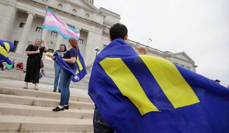 capitol offense: Demonstrators take to the steps of the Arkansas State Capitol in Little Rock in protest of homosexual discriminatory language in the Religious Freedom Restoration Act. Changes were signed into law by Gov. Asa Hutchinson. (Associated Press photographs)
