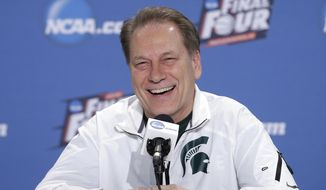 Michigan State head coach Tom Izzo smiles during a news conference for the NCAA Final Four tournament college basketball semifinal game Thursday, April 2, 2015, in Indianapolis. (AP Photo/Darron Cummings)