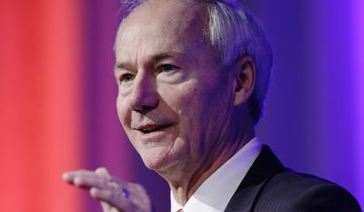 Arkansas Gov. Asa Hutchinson revealed that his son, Seth, signed a MoveOn.org petition against Arkansas' religious freedom bill. (Associated Press)