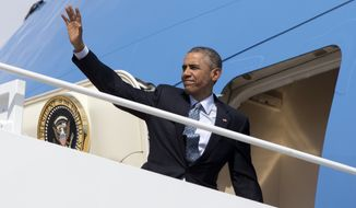 President Barack Obama waves as he boards Air Force One, Thursday, April 2, 2015, at Andrews Air Force Base, Md. (AP Photo/Carolyn Kaster) **FILE**