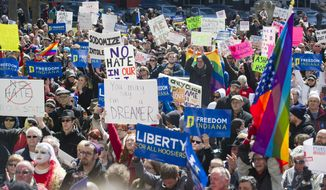 Thousands of opponents of Indiana Senate Bill 101, the Religious Freedom Restoration Act, rally against the legislation on the lawn of the Indiana State House. (Associated Press)