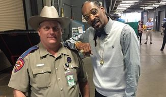 Texas Department of Public Safety Trooper Billy Spears is reportedly being forced to undergo counseling after he posed for a photo with Snoop Dogg while working at the South by Southwest music festival in Austin. (Instagram/@snoopdogg)