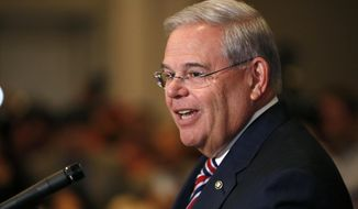 U.S. Sen. Bob Menendez speaks during a news conference, Wednesday, April 1, 2015, in Newark, N.J. Mr. Menendez, the top Democrat on the U.S. Senate Foreign Relations Committee, was indicted on corruption charges, accused of using his office to improperly benefit an eye doctor and political donor. (AP Photo/Julio Cortez)
