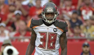 Tampa Bay Buccaneers free safety Dashon Goldson (38) waits for a play during the second half of an NFL football game against the St. Louis Rams in Tampa, Fla., Sunday, Sept. 14, 2014.(AP Photo/Phelan M. Ebenhack)