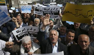 "Holding anti-US and anti-Israeli placards, Iranian worshippers attend a rally after their Friday prayers to condemn Saudi-led airstrikes against Yemen, in Tehran, Iran, Friday, April 3, 2015. The placards at right reads: ""Death to the Saudi family."" (AP Photo/Vahid Salemi)"