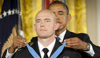 President Obama awards Staff Sgt. Ty Carter the Medal of Honor on April 26, 2013. (Associated Press) ** FILE **