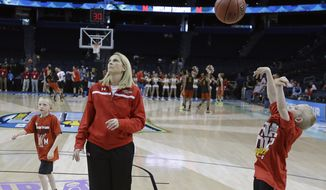 Maryland head coach Brenda Frese shoots with her sons Markus Thomas, left and Tyler Thomas during a practice session for the NCAA Final Four tournament women's college basketball semifinal game, Saturday, April 4, 2015, in Tampa, Fla. Maryland will play Connecticut Saturday in a semifinal game. (AP Photo/John Raoux)