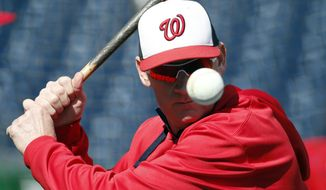 Washington Nationals manager Matt Williams prepares to hit a ball during batting practice before an exhibition baseball game against the New York Yankees at Nationals Park, Saturday, April 4, 2015, in Washington. (AP Photo/Alex Brandon)