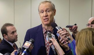 FILE - In this Jan. 29, 2015 file photo, Illinois Gov. Bruce Rauner speaks to reporters after a speech at the University of Illinois in Champaign, Ill. Rauner has made the idea of local right-to-work zones a key piece of his speeches on economic revival since he took office. His ideas have stirred union workers and drawn the attention of outside groups that back right-to-work laws. (AP Photos/News-Gazette/Rick Danzl, File) MANDATORY CREDIT