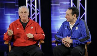 Wisconsin head coach Bo Ryan and Duke head coach Mike Krzyzewski talk during a CBS Sports interview for the NCAA Final Four college basketball tournament championship game Sunday, April 5, 2015, in Indianapolis. (AP Photo/David J. Phillip)