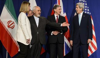 FILE - In this file photo taken Thursday, April 2, 2015, from left, EU High Representative for Foreign Affairs and Security Policy, Federica Mogherini, Iranian Foreign Minister, Mohammad Javad Zarif, British Foreign Secretary, Philip Hammond, and U.S. Secretary of State, John Kerry, line up for a press announcement after a new round of Nuclear Iran Talks in the Learning Center at the Swiss federal Institute of Technology (EPFL) in Lausanne, Switzerland. If, as critics contend, the nuclear framework deal between world powers and Tehran ends up projecting U.S. weakness instead, that could embolden rogue states and extremists alike, and make the region's vast array of challenges even more impervious to Western intervention. (AP Photo/Keystone, Jean-Christophe Bott, File)