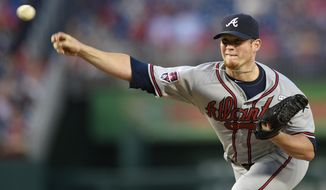 FILE- In this Sept. 10, 2014, file photo, Atlanta Braves relief pitcher Craig Kimbrel delivers a pitch against the Washington Nationals during the ninth inning of a baseball game in Washington. In a trade announced Sunday, April 5, 2015, the San Diego Padres acquired Kimbrel and outfielder Melvin Upton from the Atlanta Braves for outfielders Carlos Quentin and Cameron Maybin, plus two minor leaguers and a draft pick. (AP Photo/Nick Wass, File)