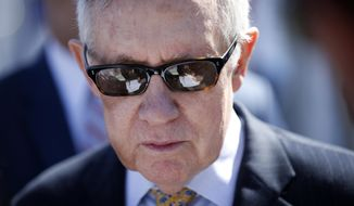 Senate Minority Leader Harry Reid, D-Nev., attends a groundbreaking ceremony for the Interstate 11 Boulder City bypass project Monday, April 6, 2015, in Boulder City, Nev. (AP Photo/John Locher)