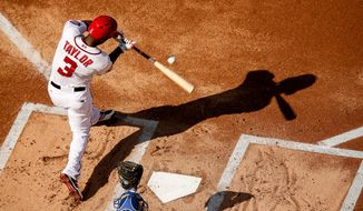 Washington Nationals right fielder Michael Taylor singles in the first inning during a baseball game between the Washington Nationals and the New York Mets on opening day at at Nationals Park, Monday, April 6, 2015, in Washington. (AP Photo/Andrew Harnik)