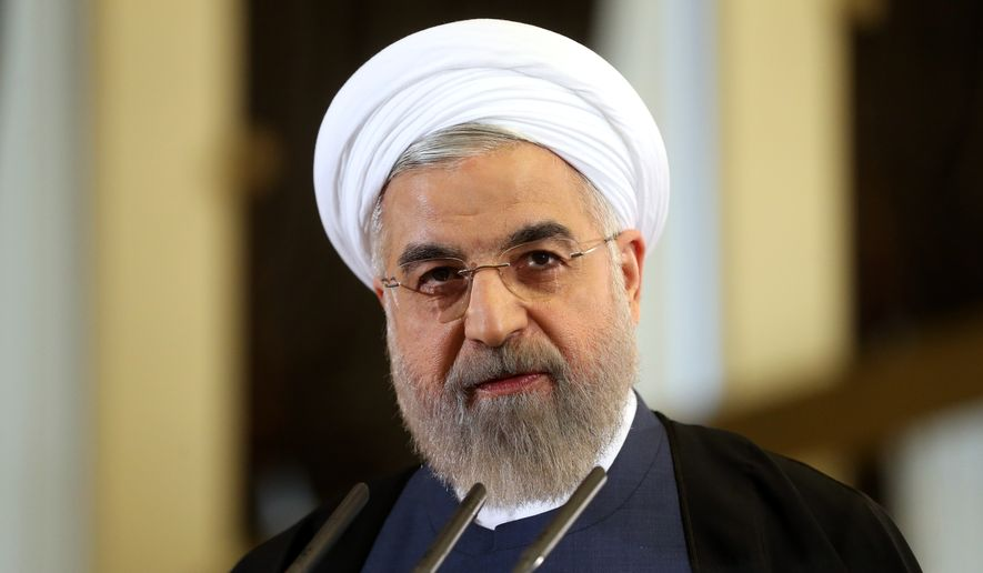 Iranian President Hassan Rouhani speaks in a news briefing at the Saadabad palace in Tehran in this Friday, April 3, 2015, file photo. (AP Photo/Ebrahim Noroozi, File)